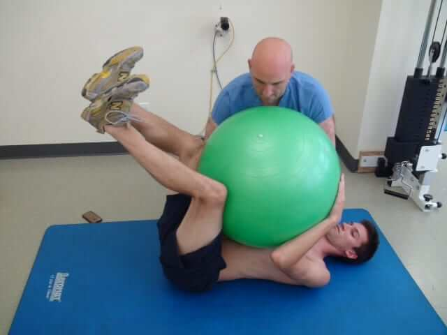 A patient during herniated disk treatment session with DNS; LEV Kalika performs