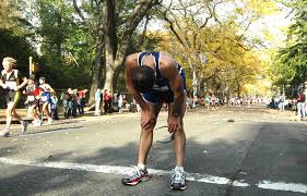 A man stops tired at NYC Marathon