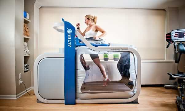 A woman is running in AlterG antigravity treadmill